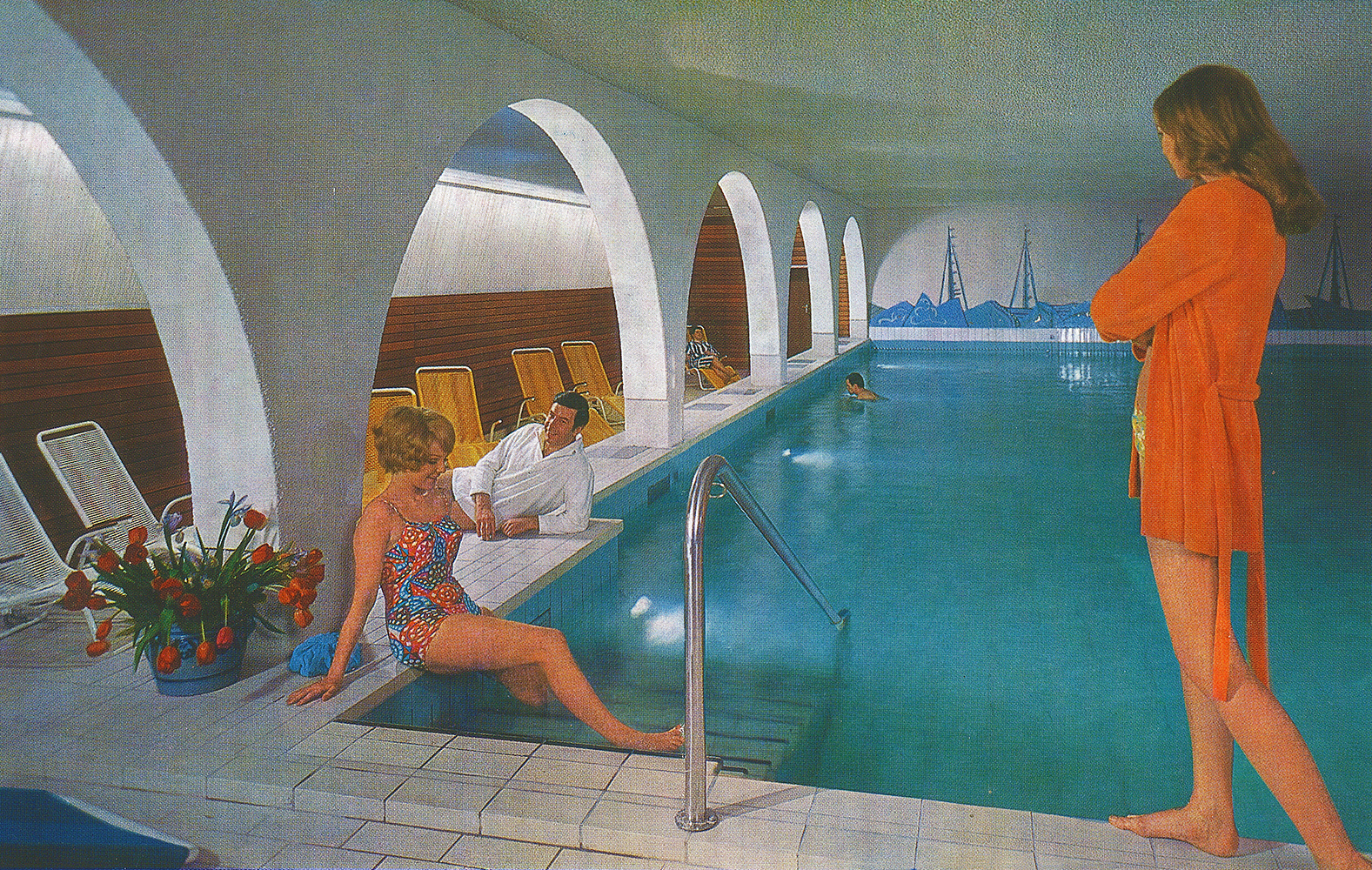 two ladies and two men in indoor swimmingpool